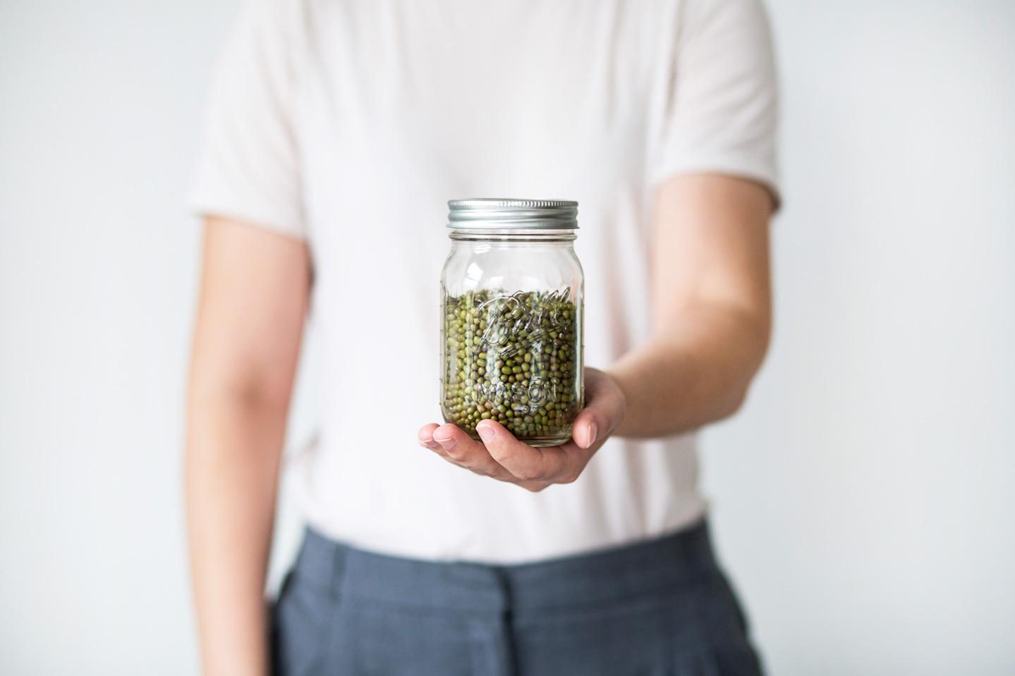 waste free packaging man holding jar