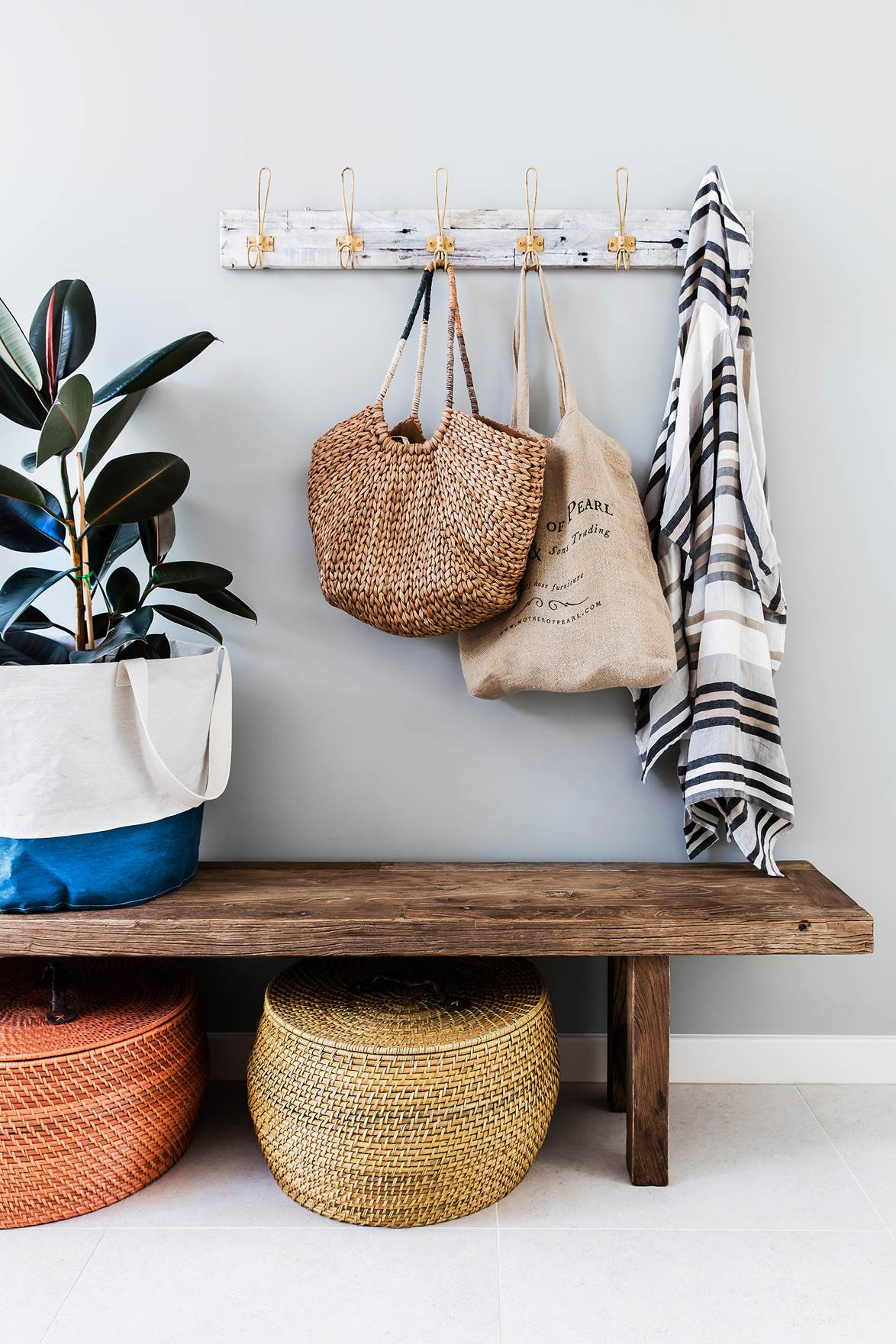 reusable bags hanging in hallway